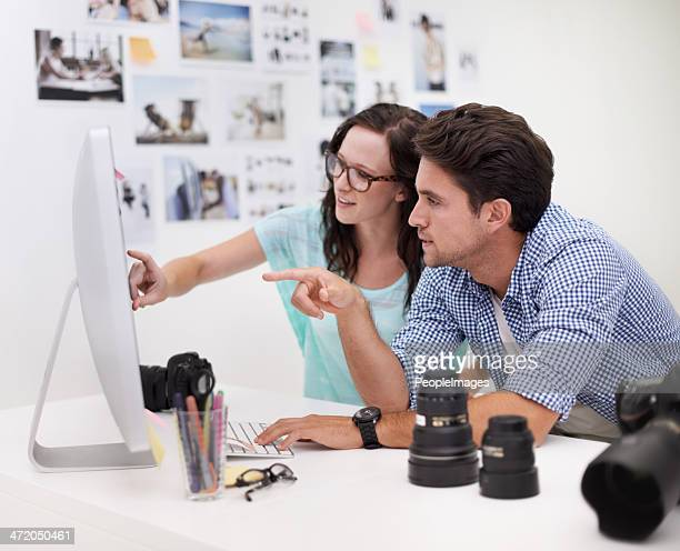 picking the perfect image - pointing at camera stock photos and pictures