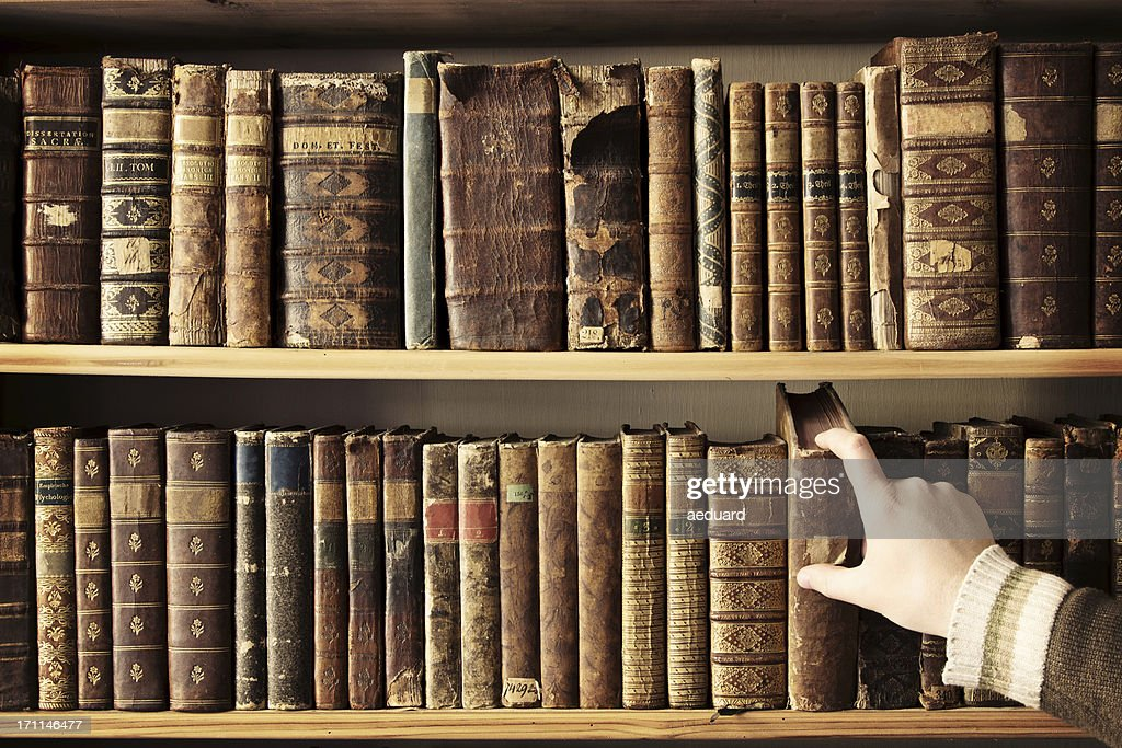 Picking the right book : Stock Photo