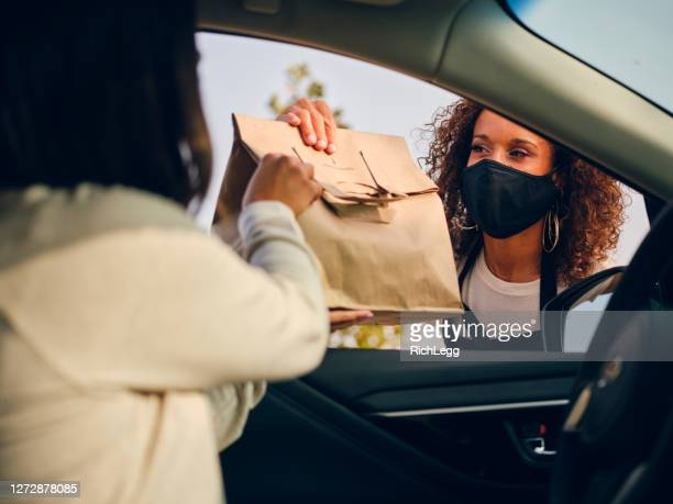 picking up curbside take out food in a cafe - serving food and drinks stock pictures, royalty-free photos & images