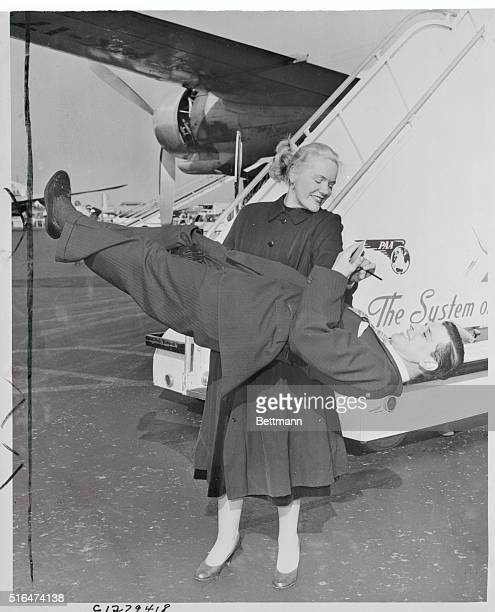 Picking up News Queens New York Joan Rhodes England's Mighty Mannequin grants an interview to 190pound reporter Arthur Treffeisen after stepping from...