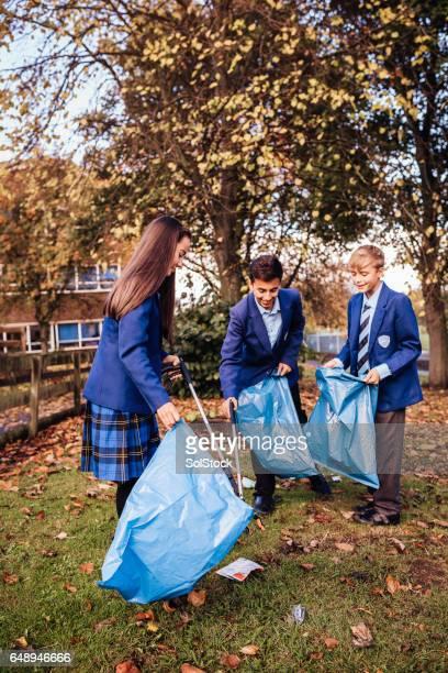 Picking up Rubbish Around their School