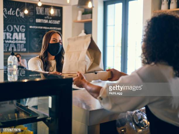 picking up take out food in a cafe - picking up stock pictures, royalty-free photos & images