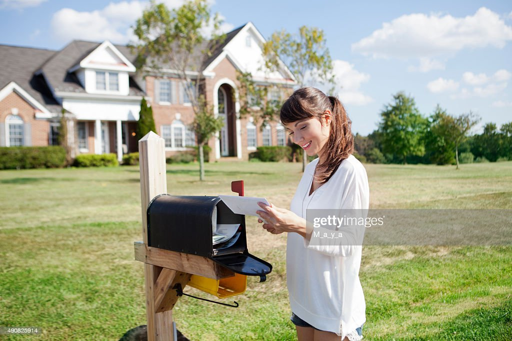 Picking up the mail : Stock Photo