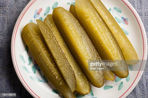 pickle wedges - sliced pickles stock photos and pictures