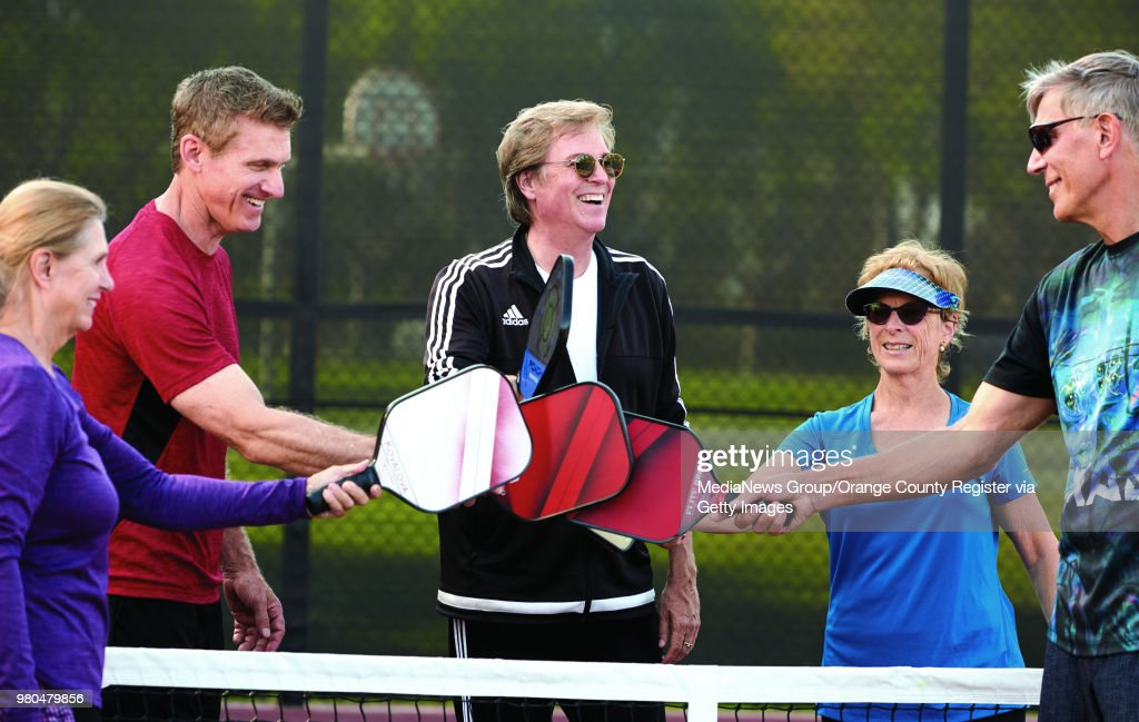 Pickleball Instructor Mike Fischer Center Congratulates His Students After Practice On The Courts