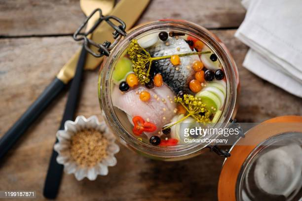pickled herring in a jar. - tradition stock pictures, royalty-free photos & images