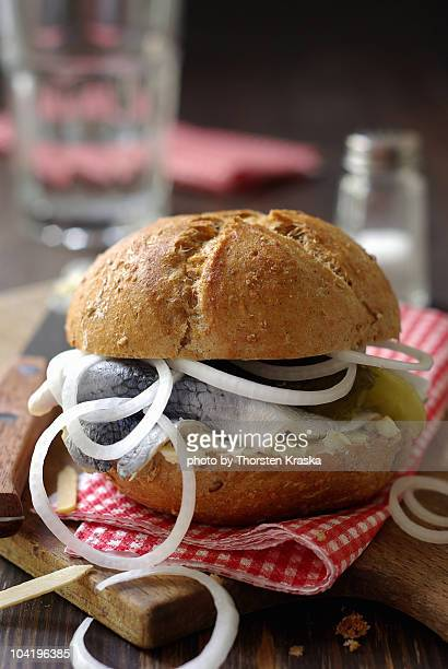 Pickled herring in a rustic bread roll