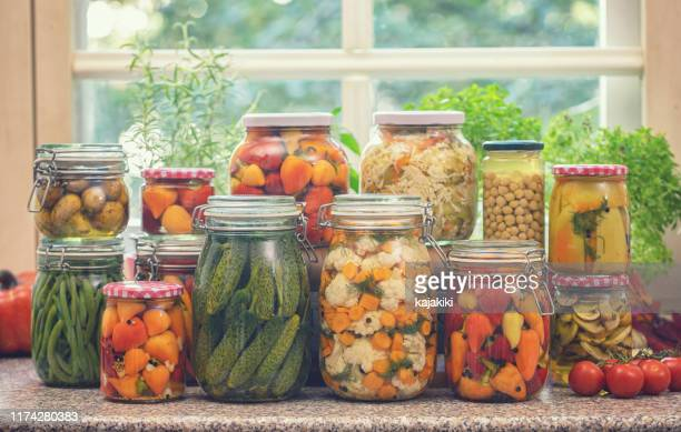 pickled organic vegetables in jars - fermenting stock pictures, royalty-free photos & images