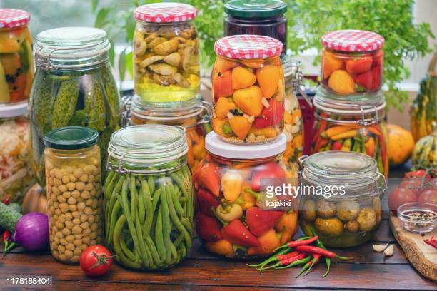 pickled organic vegetables in jars - pickled stock pictures, royalty-free photos & images