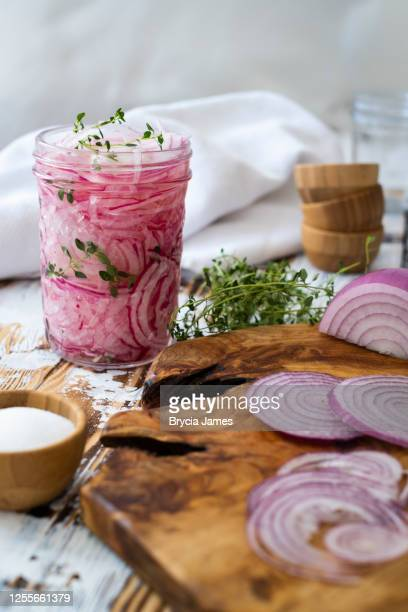 pickled red onions with thyme in a jar - brycia james stock pictures, royalty-free photos & images