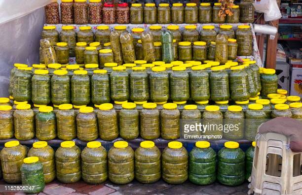 pickled vine leaves and fruits for sale in plastic bottles in buldan. - emreturanphoto stock pictures, royalty-free photos & images