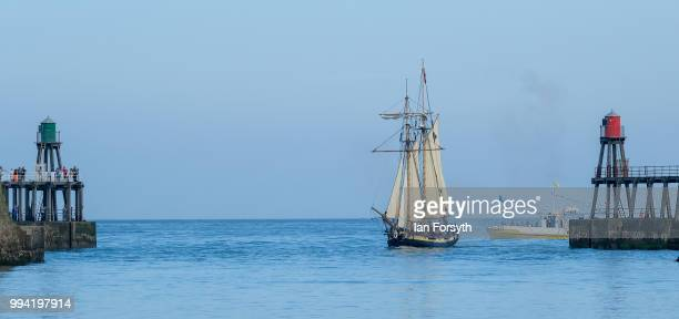 Pickles makes her way into Whitby Harbour during the first day of the Whitby Captain Cook Festival on 6 July 2018 in Whitby England HMS Pickles is a...
