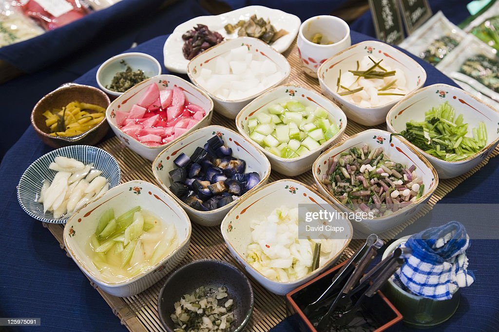 Pickles or tsukemono, a side dish or okazu, vegetables preserved in sauces, traditional Japanese cooking in a food market in Kyoto, Japan : Stock Photo