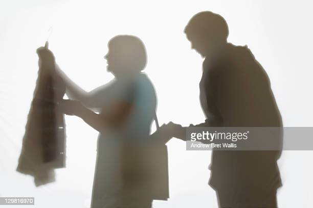 pickpocket stealing from a senior woman's handbag - andrew dieb stock-fotos und bilder