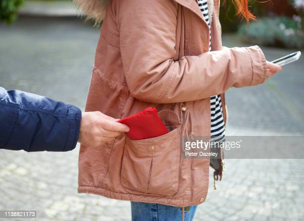 pickpocket stealing purse - victim stock pictures, royalty-free photos & images