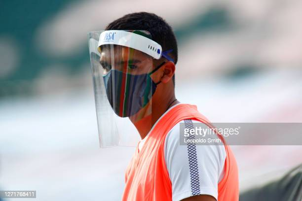 Pickup balls wear a mask during the 9th round match between Leon and Tigres UANL as part of the Torneo Guard1anes 2020 Liga MX at Leon Stadium on...