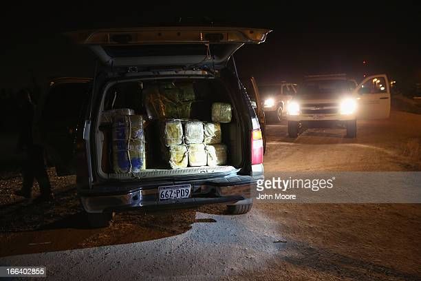 A pickup load of marijuana sits after being seized near the USMexico Border on April 11 2013 in Mission Texas US Border Patrol agents with helicopter...