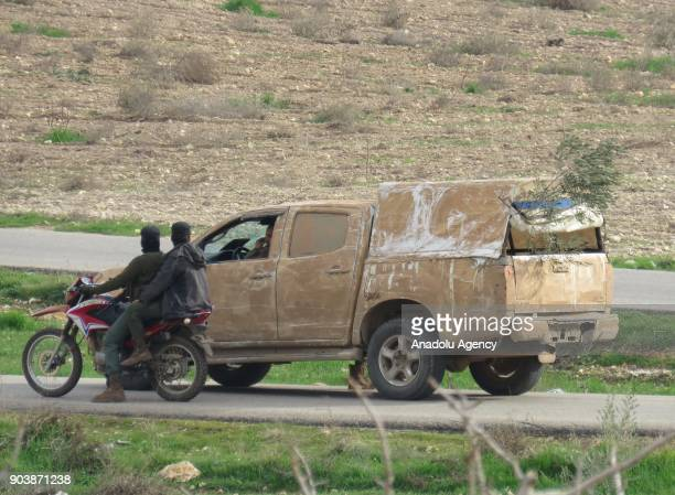 A pickup truck and a cross motorcycle are seen on a road in Idlib Syria on January 11 2018 Assad Regime and its supporter terrorist groups continue...