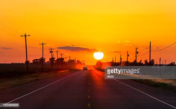 pickup truck at sunset on west texas country road - lubbock stock pictures, royalty-free photos & images