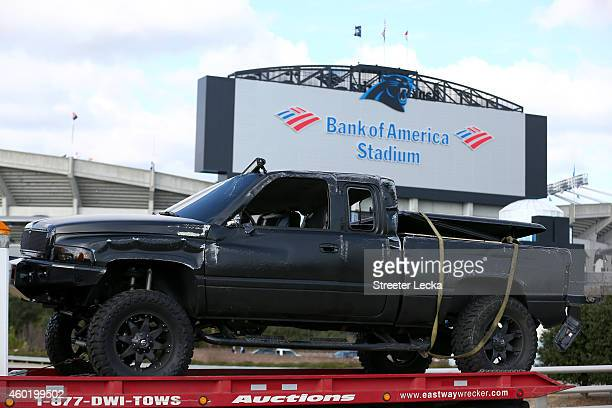 A pickup truck belonging to quarterback Cam Newton of the Carolina Panthers that was involved in a roll over accident is towed away from in front of...