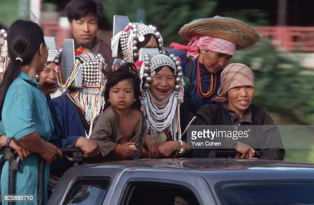 A pickup truck carrying a group of Akha hill tribe people passes through Mae Salong northern Thailand Many of Thailand's hill tribes live on the...