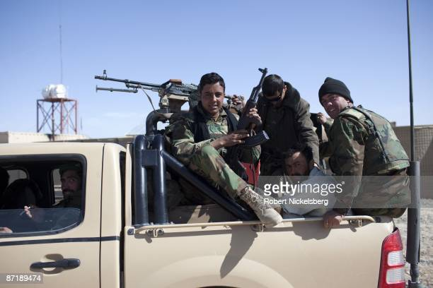 Pickup truck carrying soldiers from the Afghan National Army travels through their base shared with Afghan National Police units in Qarabagh,...