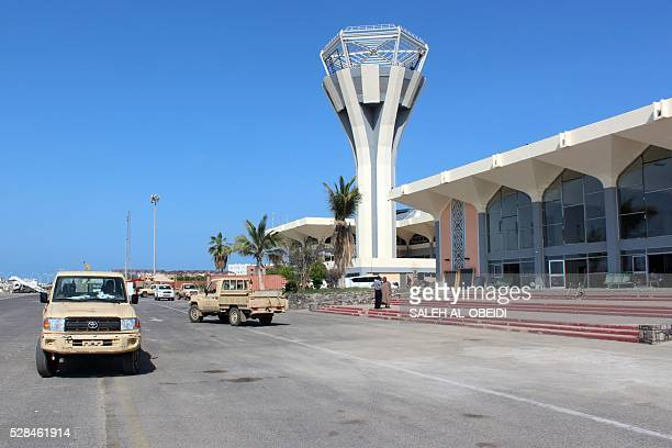 Pickup truck drive on May 5 2016 at the International Airport of the southern port city of Aden as the first passenger plane landed after the airport...