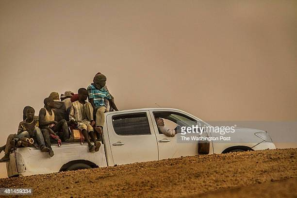 AGADEZ NIGER A pickup truck filled with migrants returns to the city of Agadez after it was turned back by military checkpoints in the Sahara desert
