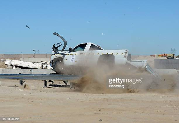 A pickup truck hits the end of a guardrail head on during a slight angle crash test at Karco Engineering LLC safety testing facility in Adelanto...