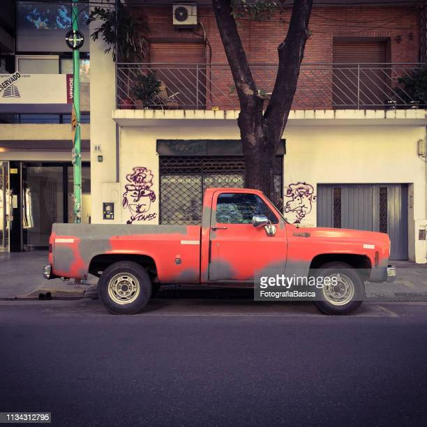 Pick-up truck in bad condition parked in the street