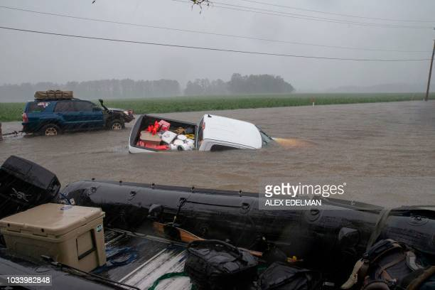 TOPSHOT A pickup truck is seen submerged in floodwater in Lumberton North Carolina on September 15 2018 in the wake of Hurricane Florence Besides...