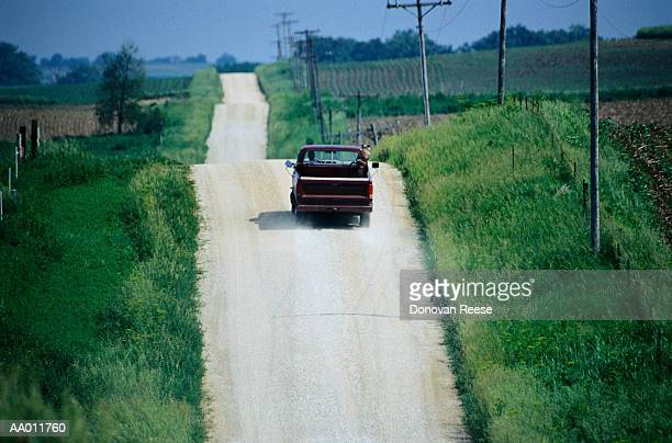Pickup Truck on a Road Through Fields