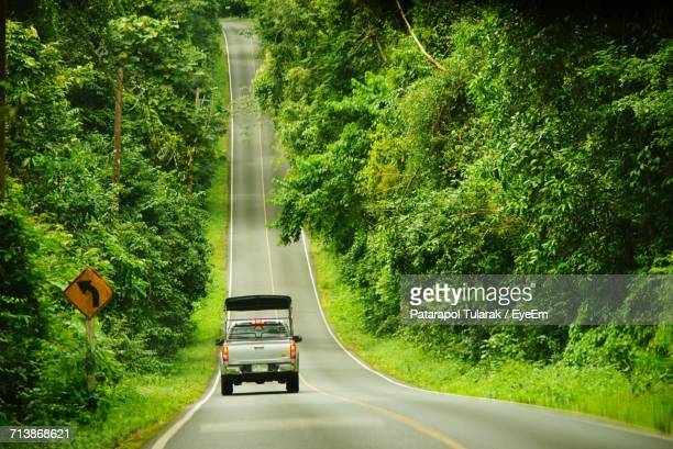 Pick-Up Truck On Road Amidst Trees At Khao Yai National Park