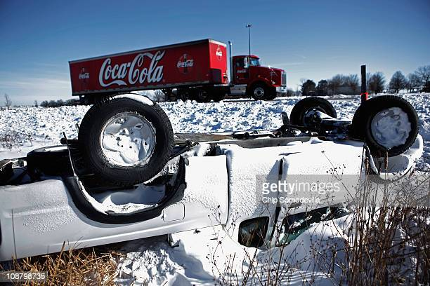 Pickup truck sits upside down in a ditch along I-380 February 3, 2011 between Cedar Rapids and Iowa City, Iowa. A massive winter storm smashed into a...