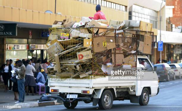 Pick-up truck transports cardboard to be recycled in downtown Pietermaritzburg on June 14, 2010. AFP PHOTO / JUAN MABROMATA