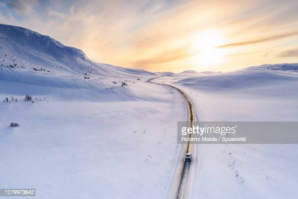 pick-up truck traveling on snowy road, sennalandet, finnmark, norway - polar climate stock pictures, royalty-free photos & images