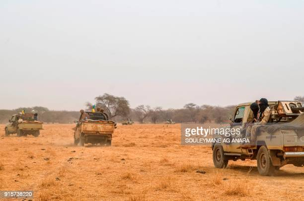 Pickup trucks belonging to militants of The Movement for the Salvation of Azawad are seen patrolling along the MaliNiger border in the deserted area...