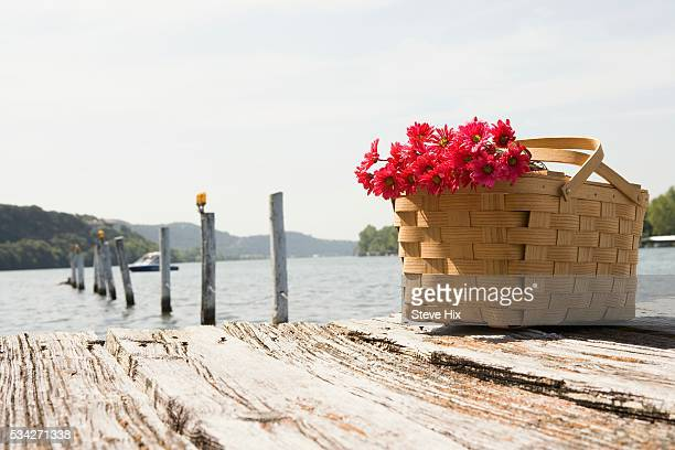 Picnic Basket with Bouquet on a Dock