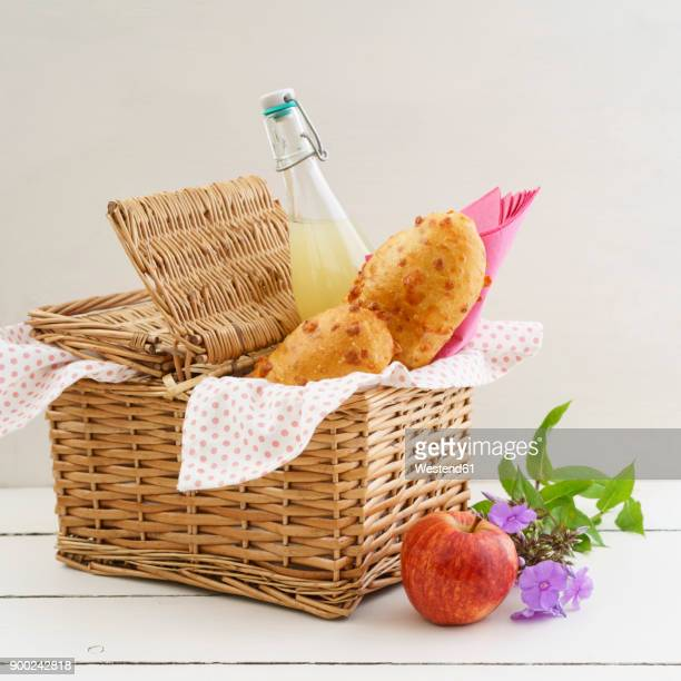 picnic basket with cheese baguettes and fruit juice - picnic basket stock pictures, royalty-free photos & images
