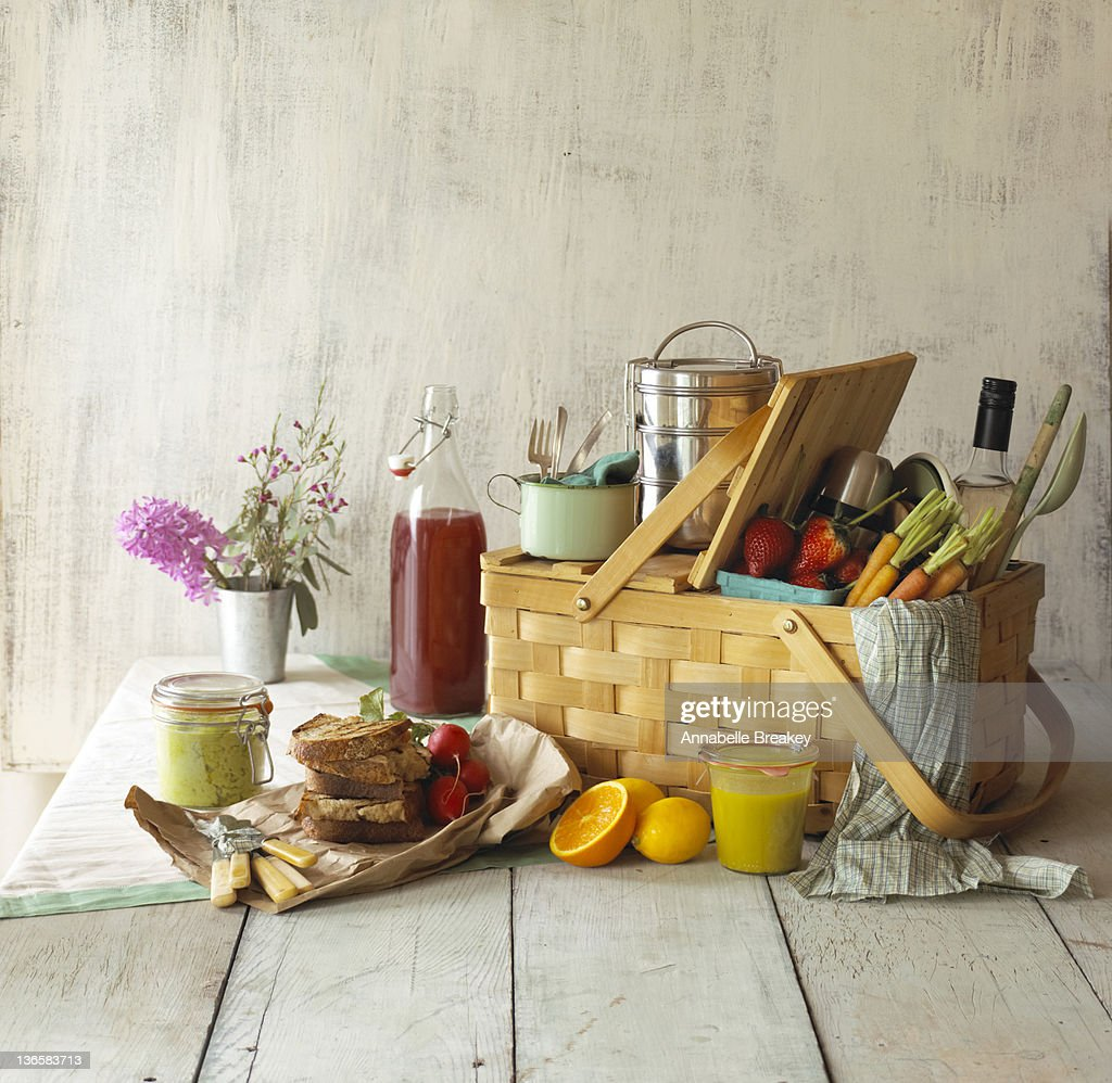 Picnic Basket with Food and Flowers : Stock Photo