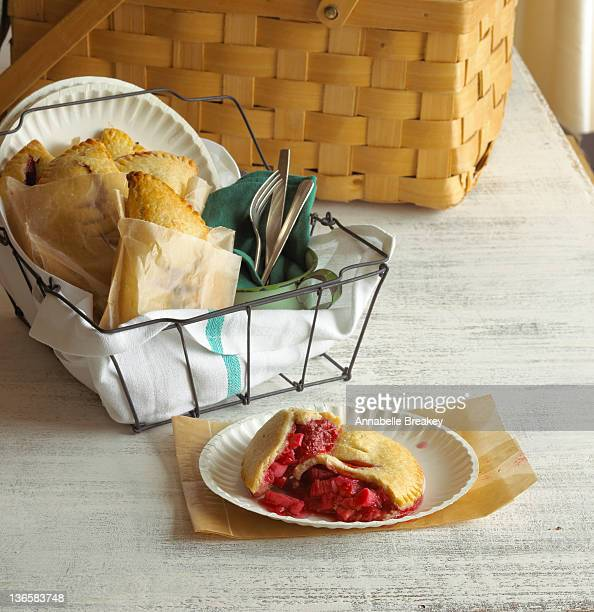 picnic basket with strawberry hand pies - paper plate stock photos and pictures