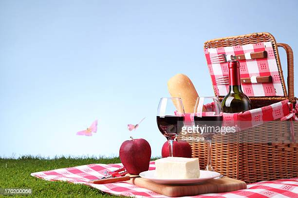 A picnic basket with wine and cheese