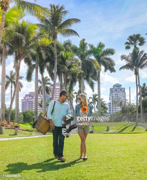 picnic couple perfect day in the tropics - west palm beach stock pictures, royalty-free photos & images