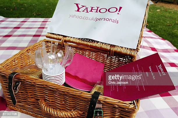 A picnic hamper is laid out for dating syndicate members at a summer picnic where they can mingle with potential dates at the latest dating...