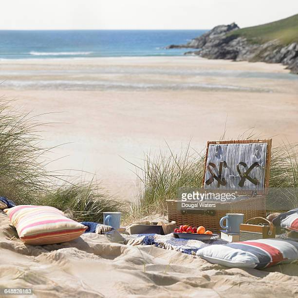picnic in dunes at beach. - hamper stock pictures, royalty-free photos & images