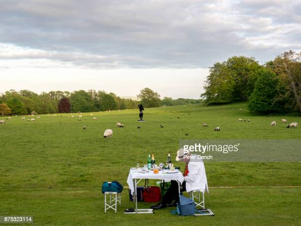 A picnic on the lawn at Glyndebourne during the interval at the opera Glyndebourne is an English country house the site of an opera house that since...