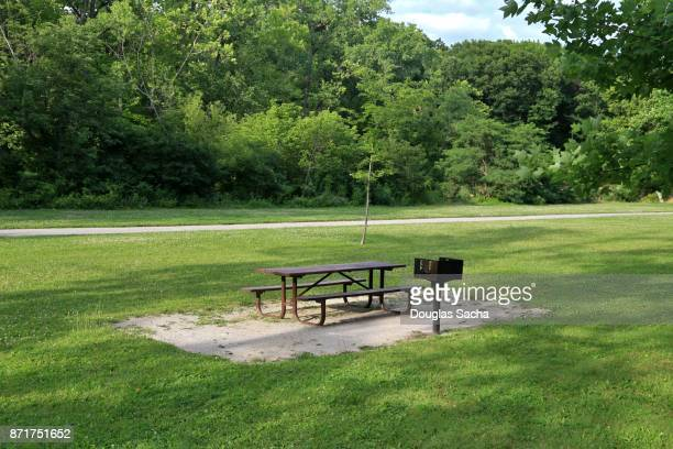 picnic table and grill at a public nature park - metal grate stock photos and pictures