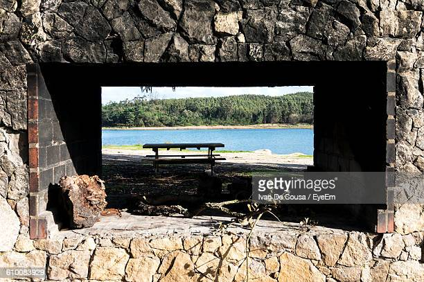 Picnic Table At Lakeshore Seen Through Window