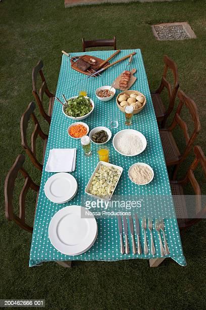 Picnic table set for dinner