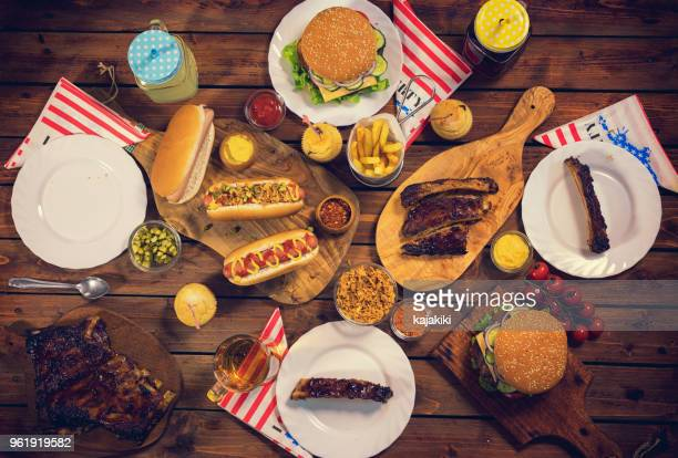 picnic table to celebrate 4th of july - sparerib stock photos and pictures